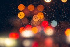 Blur rainy night bokeh city road romantic colorful stock image