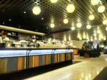 Blur Restaurant with Colorful Long Table Royalty Free Stock Images