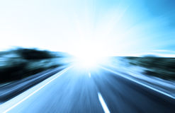 Blur road and sun Royalty Free Stock Images