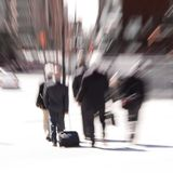 Blur of rushing businessmen Stock Photos
