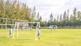 Blur shot of soccer field at school on day time image. Royalty Free Stock Image