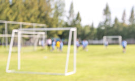 blur shot of soccer field at school on day time image. Royalty Free Stock Photo