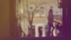 Blur Silhouette of Unrecognizable Female Figure, Mother Pushing Baby in Prams on The Street stock footage