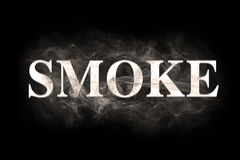Blur smoke text over the black background Stock Images