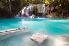 Blur stream waterfalls in deep forest national park of Thailand Stock Image