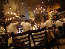 The Blur of Talent. Upscale restaurant in full bloom Stock Photography