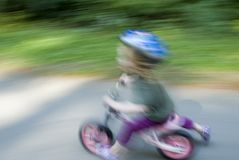 Blur of toddler on bike Stock Images