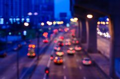 Blur traffic road with bokeh of car light in the evening at Bang. Kok Thailand, abstract background of transportation and travel concept royalty free stock image
