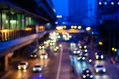 Blur traffic road with bokeh of car light in the evening at Bang. Kok Thailand, abstract background of transportation and travel concept stock images