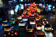 Blur traffic road with bokeh of car light in the evening at Bang. Kok Thailand, abstract background of transportation and travel concept royalty free stock photography