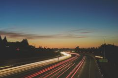 Blur of traffic at sunset Stock Photography