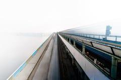 Blur train on the bridge. Train on the bridge with cars Stock Photography