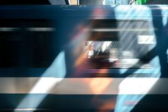 Blur of train through station Stock Photo