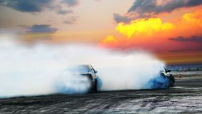 Blur of two drifting cars battle on speed track at sunset. Motor. Sport concept stock photography