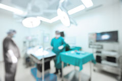 Blur of two veterinarian surgeons in operating room Royalty Free Stock Image