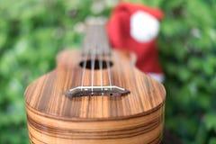 Blur ukulele with christmas hat Royalty Free Stock Photography