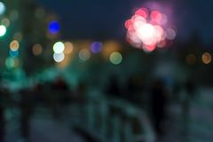 Blur view of fireworks and celebrating people with bright round bokeh royalty free stock photo