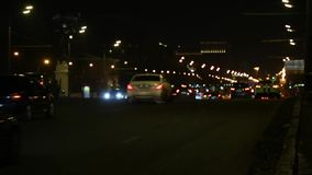 Blur view of traffic in illuminated city at night or evening. Blur view of traffic in illuminated city at night stock video footage