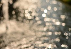 Blur water with sunlight bokeh Stock Photography