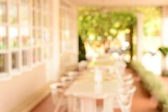 Blur white chair and table in restaurant Stock Photo