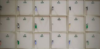 Blur White lockers with a keys and number for save value things Royalty Free Stock Photos