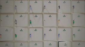 blur white lockers with a keys and number for save value things Royalty Free Stock Photo