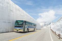 Blur windshield bus move along snow wall at tateyama kurobe alpine route. Blur windshield bus move along snow wall at japan alps tateyama kurobe alpine route Royalty Free Stock Photos