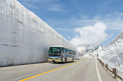 Blur windshield bus move along snow wall at tateyama kurobe alpine route. Blur windshield bus move along snow wall at japan alps tateyama kurobe alpine route Royalty Free Stock Images