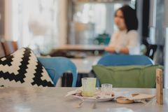Women sit and wait to negotiate business in the restaurant. Blur Women sit and wait to negotiate business in the restaurant stock photography