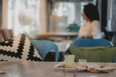Women sit and wait to negotiate business in the restaurant. Blur Women sit and wait to negotiate business in the restaurant stock image