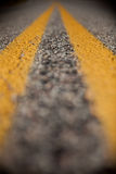 Blur. Yellow lines on the asphalt of a road Royalty Free Stock Photography