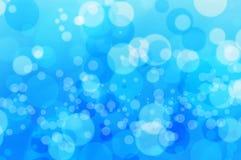 Blure bokeh蓝色泡影水和背景 免版税库存照片