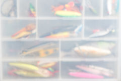 Blure fishing wobblers in storage box Royalty Free Stock Photo