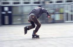 blured影片谷物溜冰者 免版税库存照片