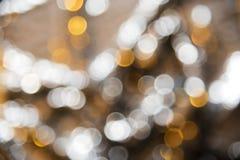 Blured金黄光背景、党、庆祝或者圣诞节纹理 库存照片