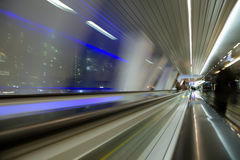 Blured abstract view from window in long corridor. In modern building on night city Royalty Free Stock Photo