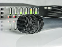 Blured audio DSP with Led Diods And Microphone in front Stock Image