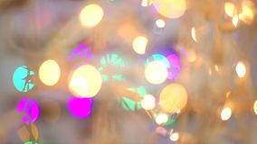 Blured blue, orange. yellow, green, purple, golden lights. Christmas and New Year Decoration. Party decor. blurred bokeh holiday abstract background. blinking stock video