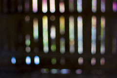 Blured bokeh  lights in a row. Abstract defocused coloured  background Royalty Free Stock Images