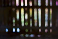 Blured bokeh steekt op een rij aan De samenvatting defocused gekleurde achtergrond Royalty-vrije Stock Afbeeldingen