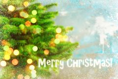 Blured holiday background with Christmas tree and bokeh lights Royalty Free Stock Photos
