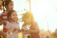 Blured image of asian children having fun to play with the rain Royalty Free Stock Images