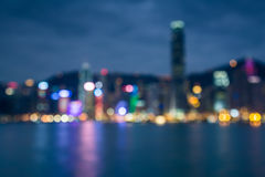 Blured lights of Hong Kong city twilight with water reflexion. Blurred city lights bokeh cityscape with water river reflexion Stock Image
