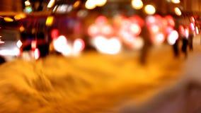 Blured night winter traffic lights, shot on lens baby, time-lapse. Defocused stock video