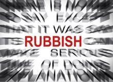 Blured text med fokusen på RUBBISH arkivfoto