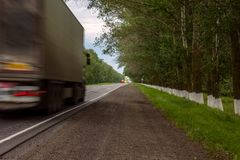 Blured truck on road. View of blurred truck on summer road stock photography