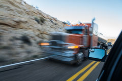 Blured truck through window of car Royalty Free Stock Photo
