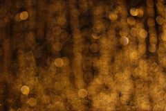 Blured yellow lights in the dark stock photography