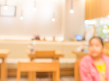 Blurr background image of young customer sit in restaurant Stock Photos