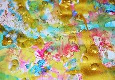 Blurred闪耀的金蓝色蜡状的柔和的淡色彩察觉水彩被弄脏的蜡状的金斑点五颜六色的颜色,刷子, backgrounnd冲程  库存图片